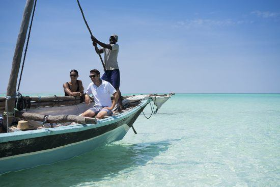 Tourits in a dhow boat in Mozambique