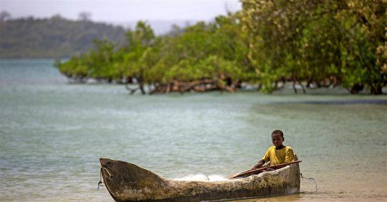 Boy in a dhow boat in Mozambique