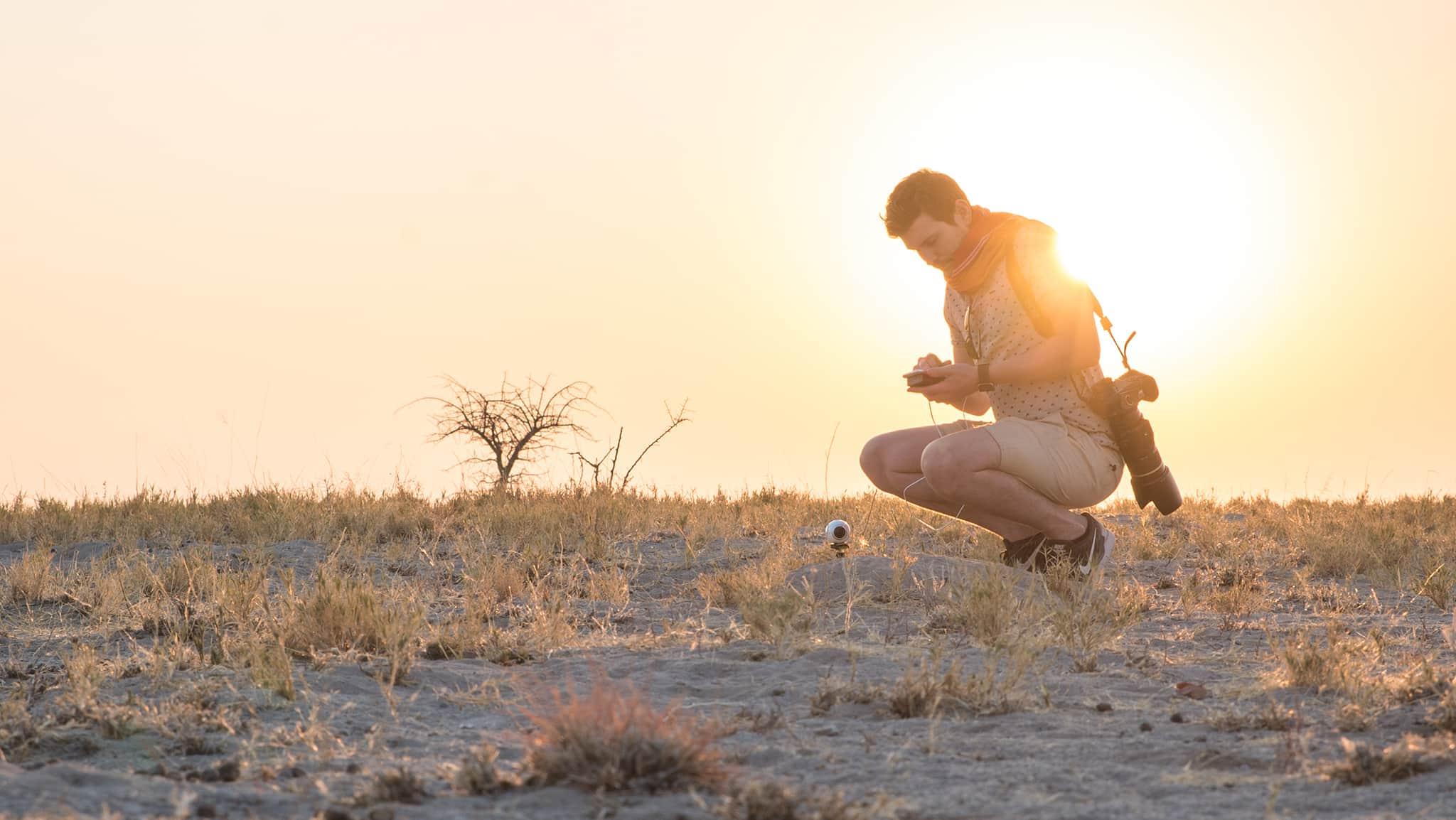 Sun setting behind a man in Jack's Camp Botswana