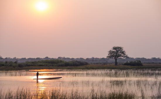 sunset mokoro vumbura plains Okavango Delta in Botswana
