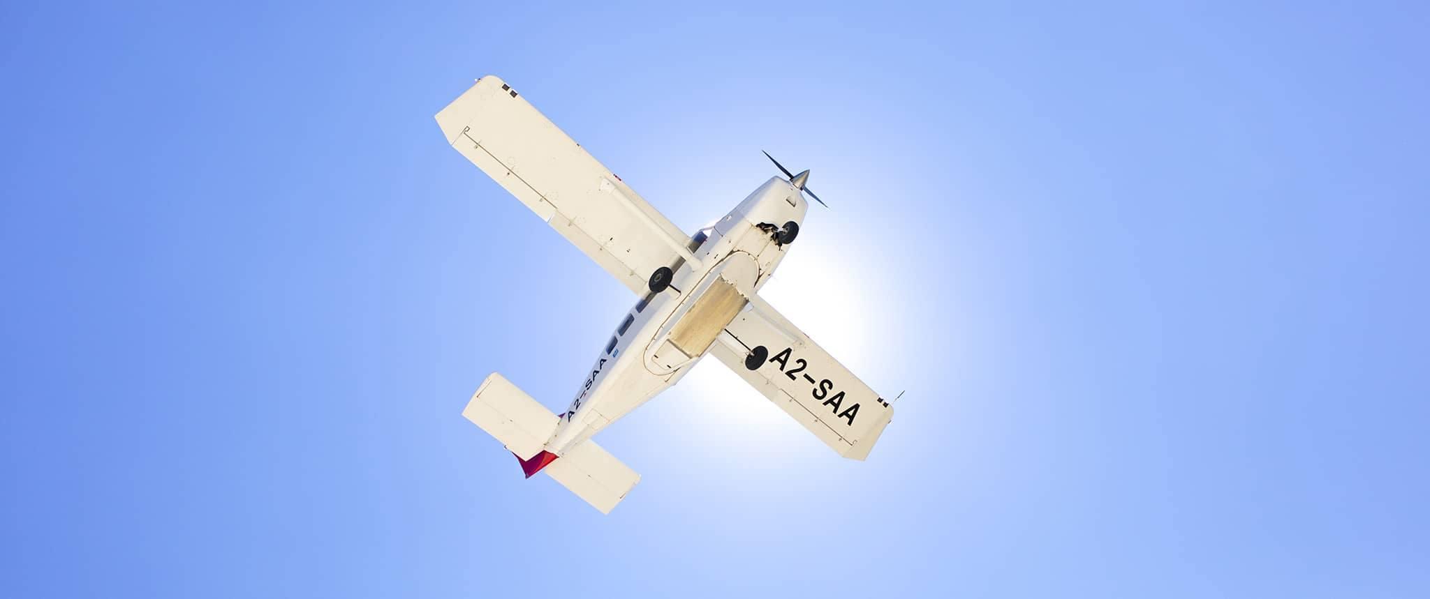 Botswana Moremi Okavango Delta airplane flying sunny