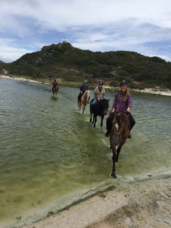 Horse riding across the lagoon to get to Noodhoek Beach