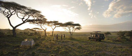 sundowners on safari with serengeti under canvas in tanzania's serengeti