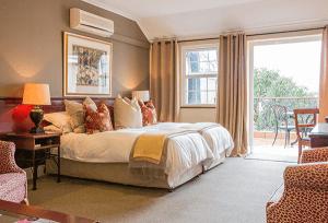 Las habitaciones de Rusthuiz, en Stellenbosch, son cálidas y confortables