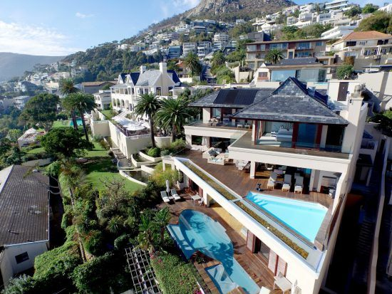 Villa One and the Spa in the foreground with the elegant Ellerman House in the background.
