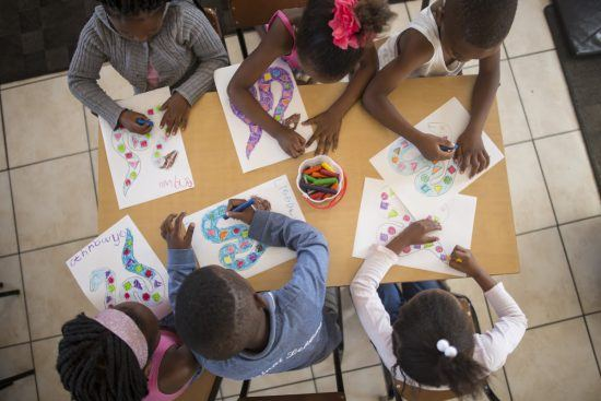 Children colouring in at Khumbulani