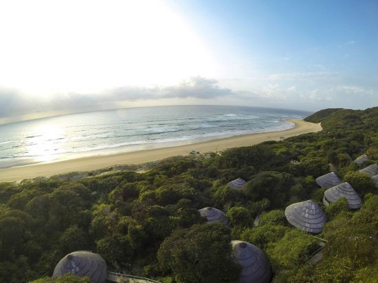 A view of the ocean from above the huts of Thonga Beach Lodge