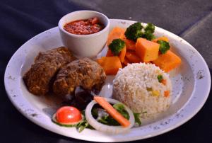 Comida en Bo-kaap Kombuis, uno de los restaurantes en Ciudad del Cabo