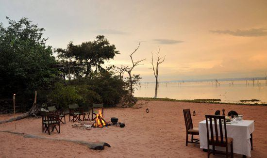 Meals are often served on the sandy shores of Lake Kariba