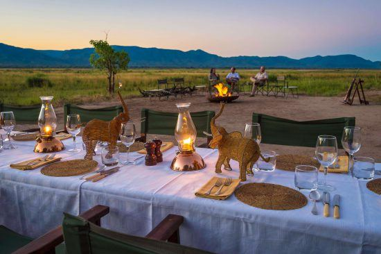 Eating in the open veld is a highlight of a John's Camp stay