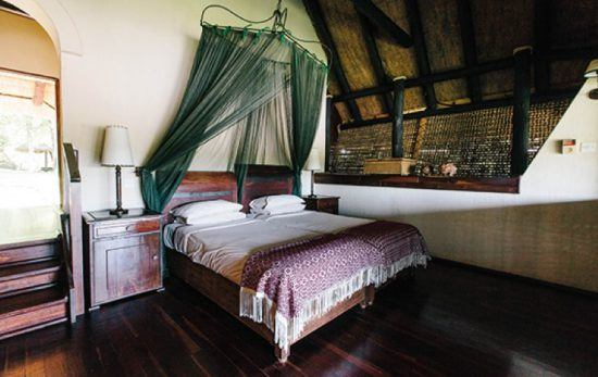 Woods and soft hues dominate inside the interiors at Chilo Gorge Safari Lodge