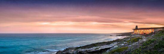 Die Lekkerwater Beach Lodge am Ozean bei Sonnenuntergang