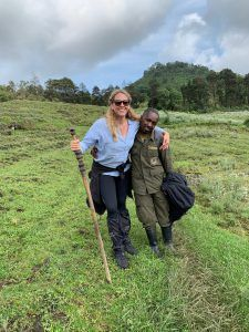 Bianca Johnstone and gorilla tracker in Rwanda