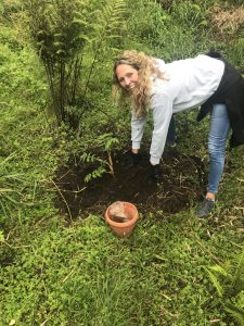 Bianca Johnstone planting a tree in the rainforest of Rwanda
