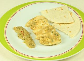 Pollo in salsa di semi di sesamo e zucca