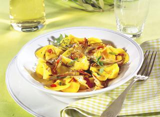 Ravioli al sugo di carciofi e pancetta