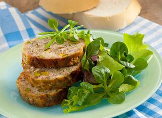 Ricetta Polpettone di pane, salsiccia e carciofi