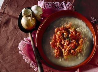 Ricetta Riso mantecato con ragù di pesce