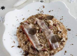 Risotto con tartufo, fegatini d'anatra e lardo