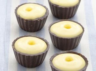 Ricetta Pirottini di cioccolato fondente ripieni di crema