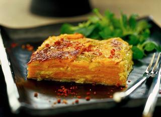 Ricetta Gratin di patate dolci al formaggio, panna e peperoni
