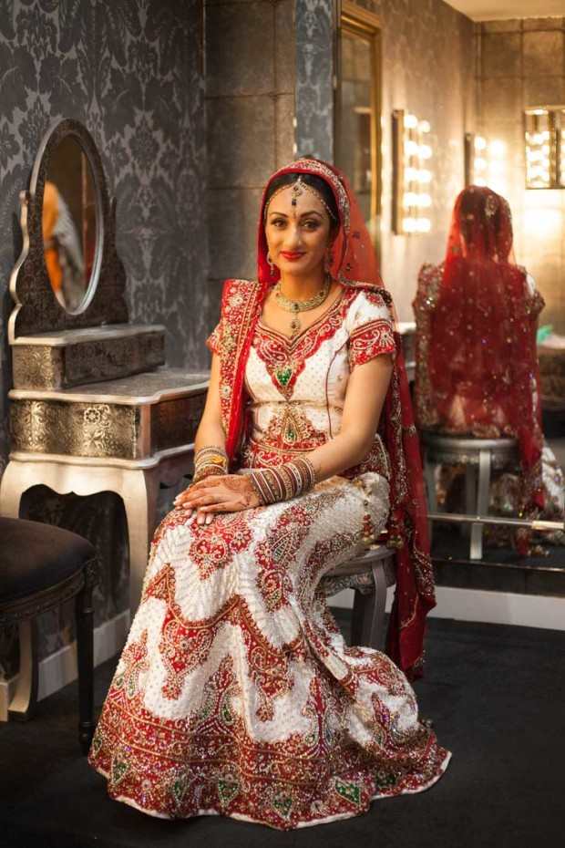 luxury indian bride wedding portrait in her luxury suite at premier banqueting in london