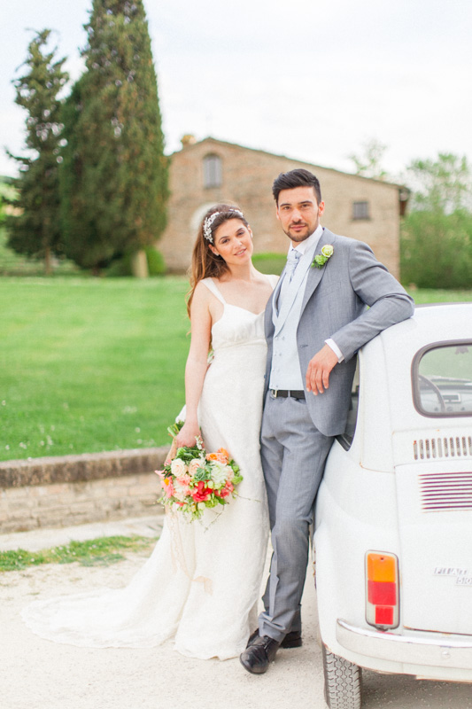 a romantic wedding portraits of an italian couple who just got married in a romantic and intimate italian wedding in the marche region of italy at urbino with an italian white fiat 500