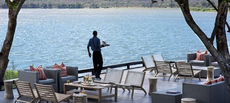 Dining on the banks of the Zambezi at Royal Chundu River Lodge