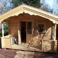 A smaller log cabin in the process of being constructed which is used as a workshop at the end of my customer