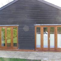 Sapele, double glazed doors for swimming pool building