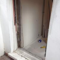 Old single glazed box frame being replaced with...