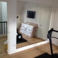 Mirrors made to measure and fitted on to a wall of a home gym