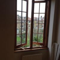 Replaced with double glazed casement frame. Stained to match existing.