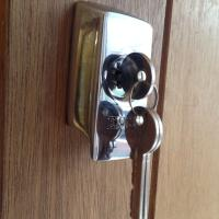British Standard Nightlatch Fitted with a high security door pull escutcheon on front door.