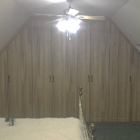 Bedroom wardrobes fitted into combe ceiling