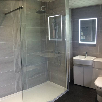 Porcelanosa tiles, bluetooth mirror and fitted bathroom units