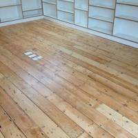 Original pine floorboards sanded and varnished.