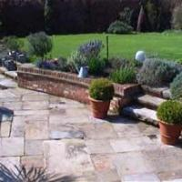 York stone patio with new flower beds