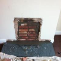 bricked up fire place hole