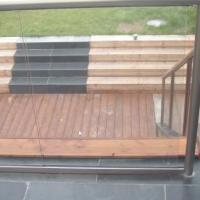 A mixture of decking and slate 