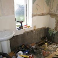 A serious bathroom refit, removal and re-siting of all services,  tiling, and installation of walk in shower with seat