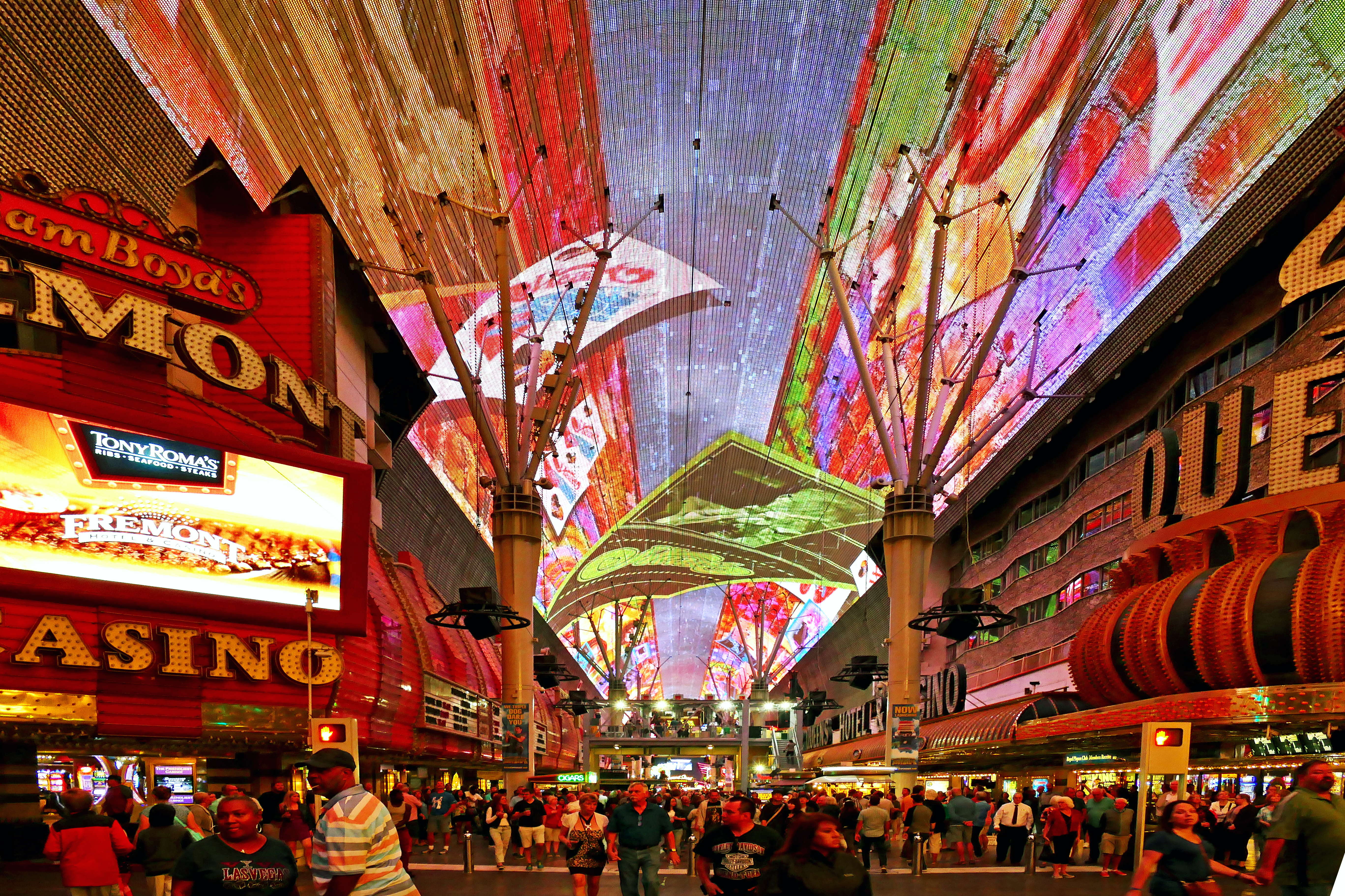 The Freemont Street Experience, Las Vegas: a pedestrian mall surrounded by lights and screens in an array of different colours.