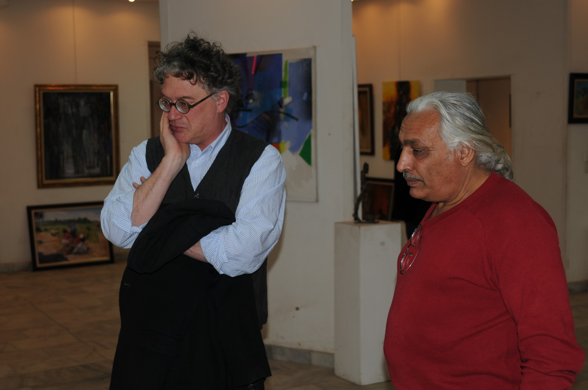 Curator Jonathan Watkins  with Qasim Sabti at the Hewar Gallery. Photo: Mohamad Al Yissari.