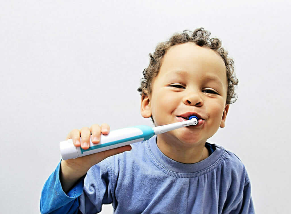 A photo of a child using a toothbrush