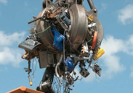 photo of electronic waste being picked up by crane