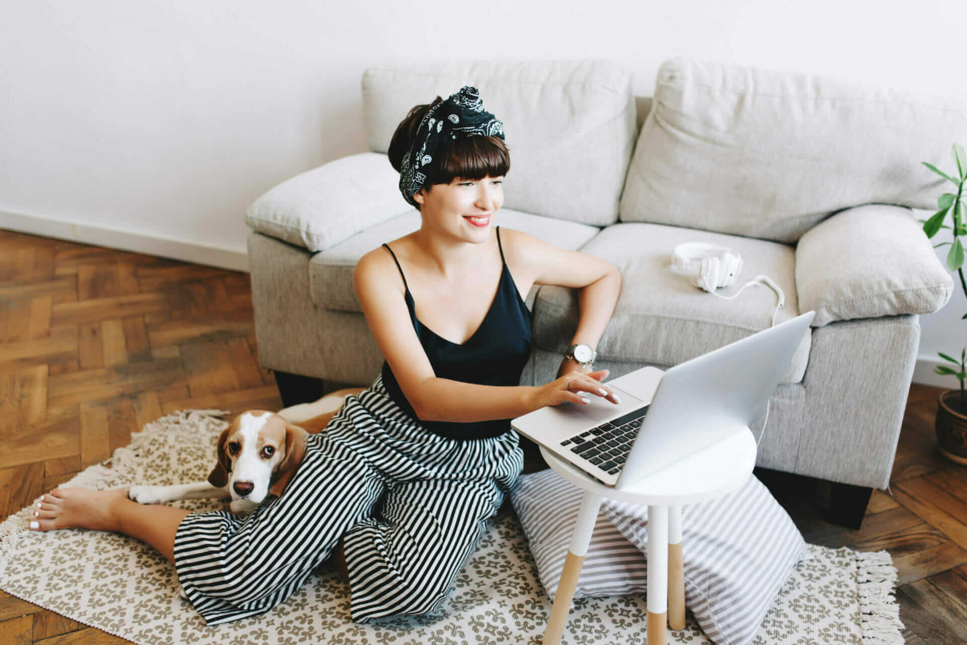 A photo of a woman using a laptop at home