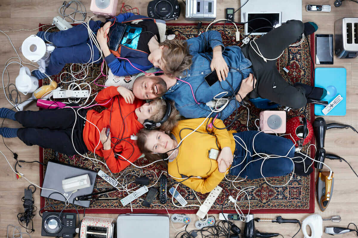 photo of man and children lying among electricals, by Gregg Segal