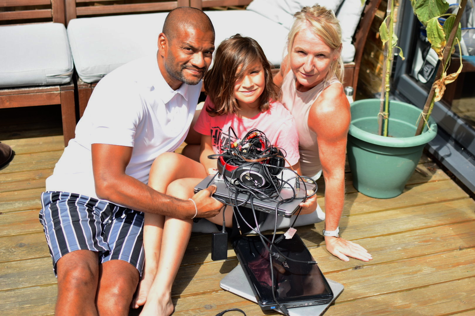 Sam Kumar and family with old electricals for recycling