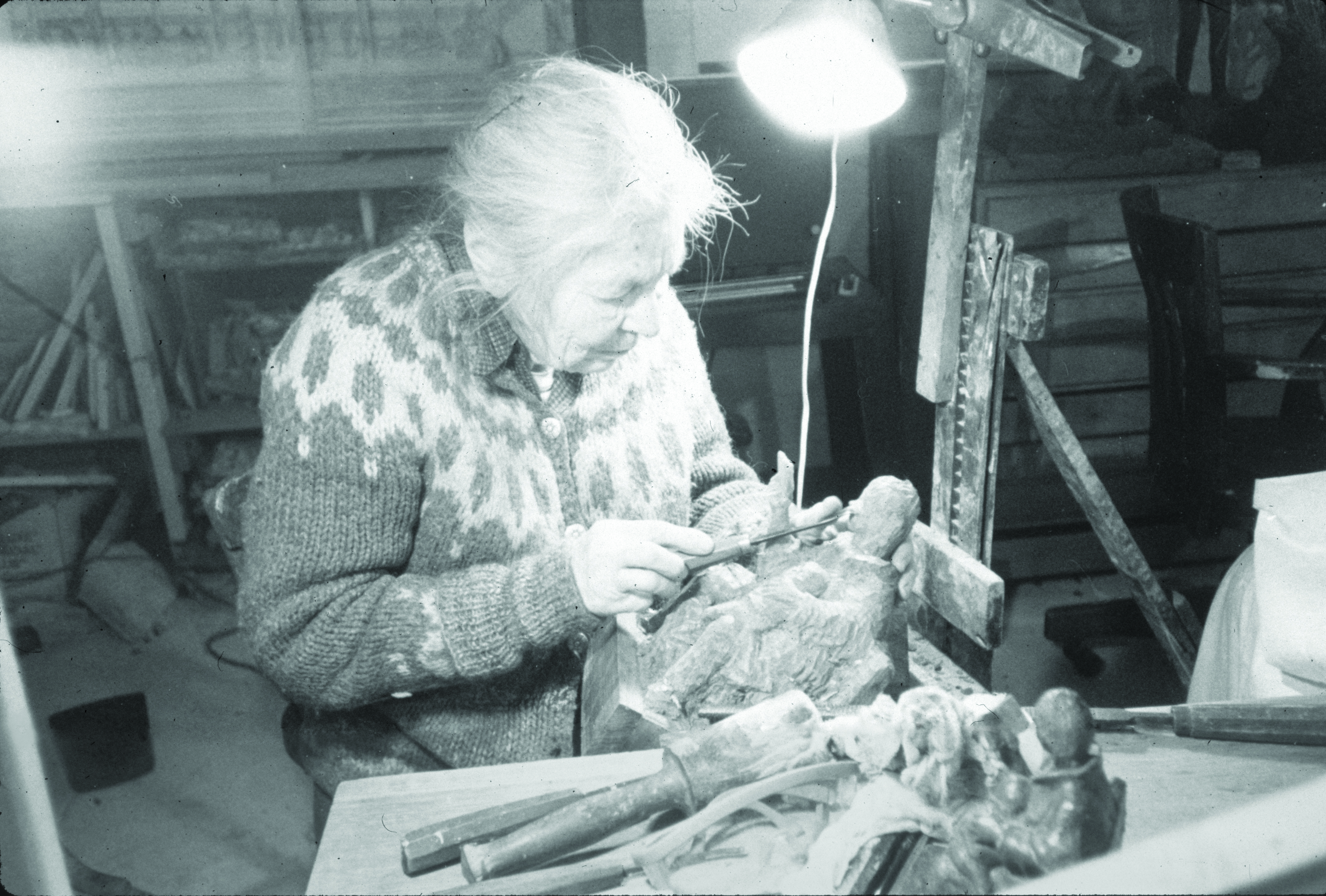 Edith carving in her loft