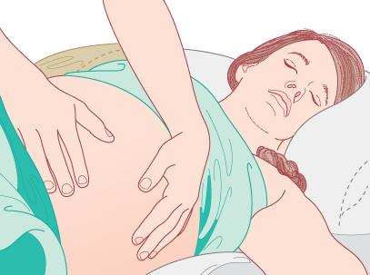 Figure 1.4 Palpation of the gravid abdomen.